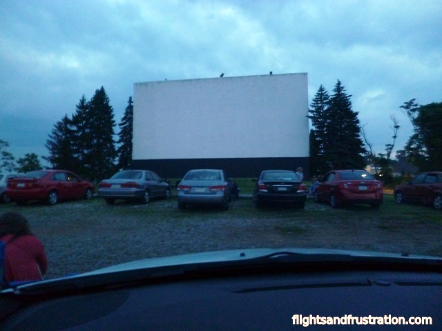 The sun is going down at the outdoor movie theatre